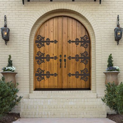 wood plank double doors on front entry of luxury home