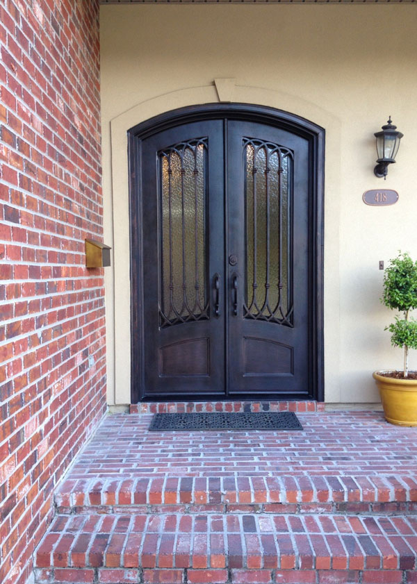 solid wood to forged iron replacement door project-after